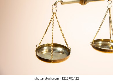 Gold scales of justice on brown background,sclaes with copyspace showing law justice or court concept