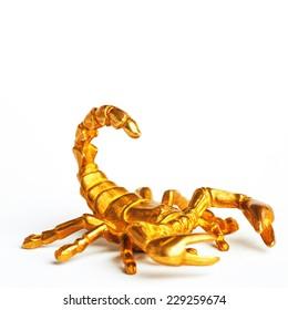 Gold scorpion isolated on white background.