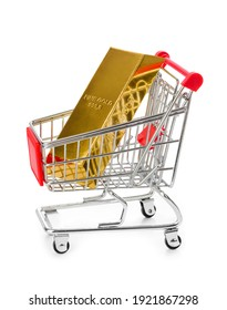 Gold in shopping cart isolated on white background