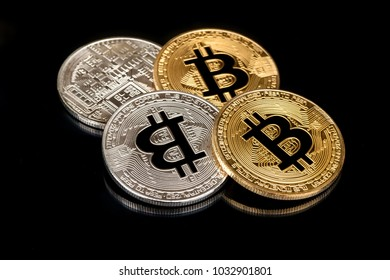 Gold and silver bitcoin coins on black background