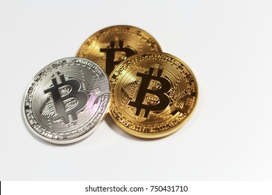 Gold and silver bitcoins isolated on white background