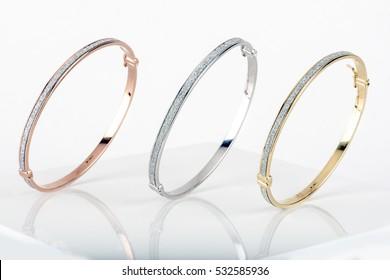Gold, Silver and Bronze Diamond Bracelets. Shot standing up.