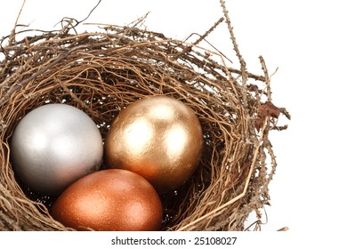 Gold, silver and bronze eggs in a real nest