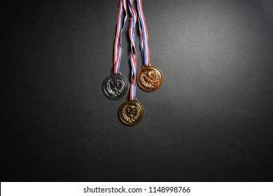 Gold, silver and bronze medal on black background - empty space