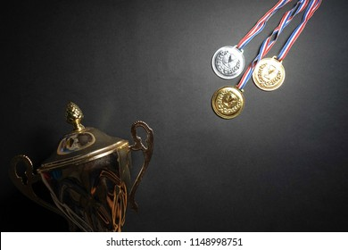 Gold, silver and bronze medal with trophy