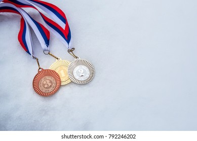 Gold, silver bronze medal. White snow background. Wallpaper for February winter olympic game in South Korea.