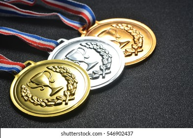 Gold, silver and bronze medals close up