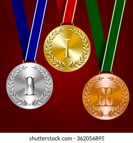 Gold, silver and bronze medals with laurel wreaths on dark red background. Contain the Clipping Path