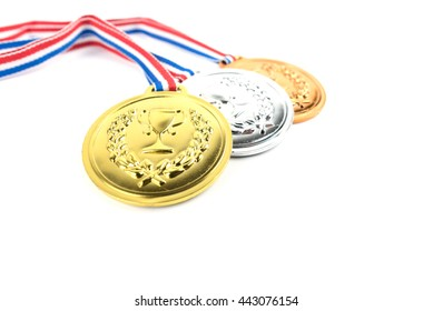 Gold, silver and bronze medals with trophy symbol on white background