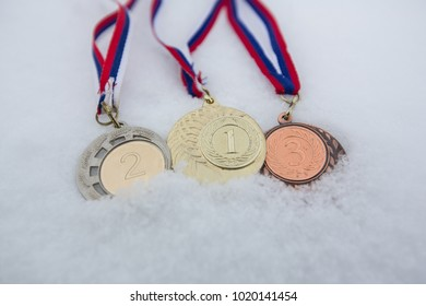 Gold, silver and bronze medals for winners in olympic winter games south korea pyeongchang 2018, world championship or tournaments in snow white background