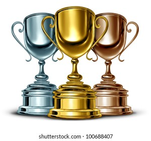 Gold silver and bronze trophies and trophy award as the best three winners of a sport or sporting competition as a symbol of sportsmanship and success in an important event on white.