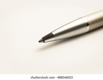 gold and silver business pen close up on white background