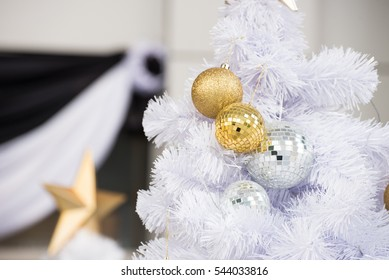 Gold and silver christmas bubbles with white tree decoration for celebration of new year