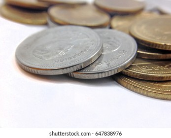 gold and silver coins of Thailand on white background