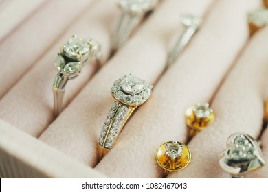 Gold and silver diamond ring and earrings in luxury jewelry box