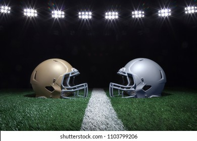 Gold and silver football helmets facing off on a yard line below stadium lights at night