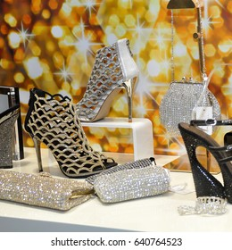 Gold and silver high-heeled shoes