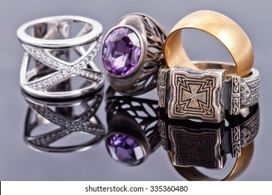 Gold and silver jewelry: the Church's signet, wedding rings and carved ring with alexandrite