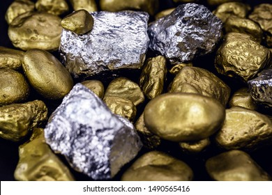 Gold and silver nuggets on black background. Precious stones, luxury concept and mineral drainage. Industrial activity, treasure and fortune.