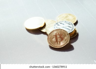 Gold and silver shiny coins with a bitcoin and lisk symbols - virtual crypto currency. Concept of trading and business in internet.
