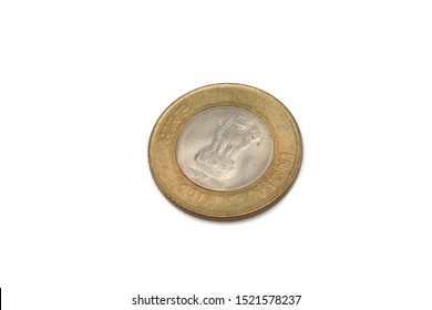 A gold and silver, ten Indian rupee coin isolated on a white background.  Shot close up in macro