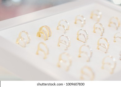 Gold and silver wedding rings collection on the display in the jewelry store