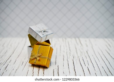 Gold and Sliver gift box isolated. Selective focus with copy space for text.