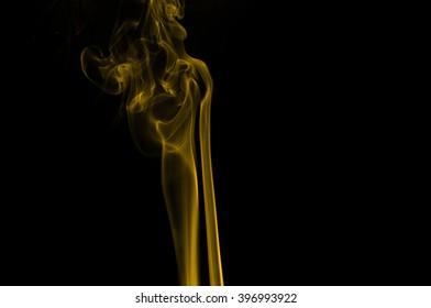 Gold smoke on black background,