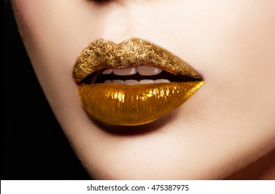 Gold sparkle lip gloss. Artistic makeup cosmetic
