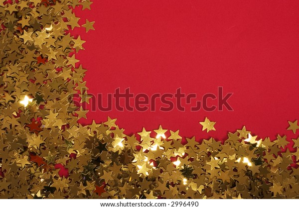 Gold stars glittering on a red background