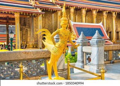 Gold statue of Kinnari, mythical creature half human half bird, at Temple of Emerald Buddha, Grand Palace complex, Bangkok, Thailand