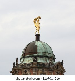 Gold Statue on top of the Servants Quarters of the New Palace, in Potsdam, Germany