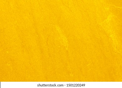 The Gold stone texture for background. gold wall background.