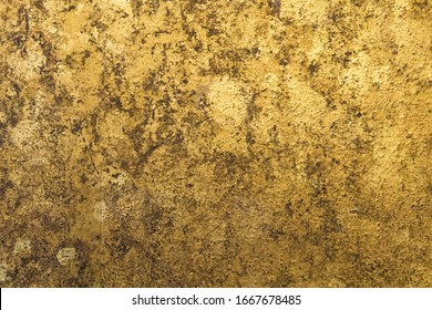Gold texture background. Color and black on wall background.
