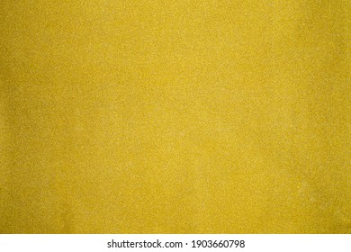 Gold texture background with Light luxury shiny shine glitter sparkle of bright reflection on golden surface, for celebration backdrop, wallpaper, Christmas decoration background.