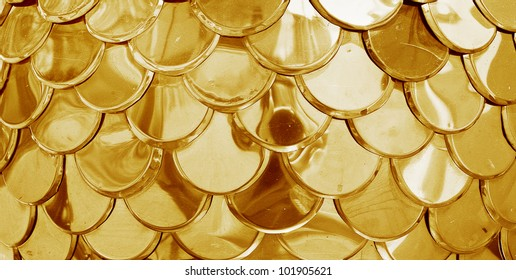 Gold tiles background with a circle elements.