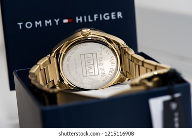 A Gold Tommy Hilfiger watch in it's presentation box, luxury, expensive
