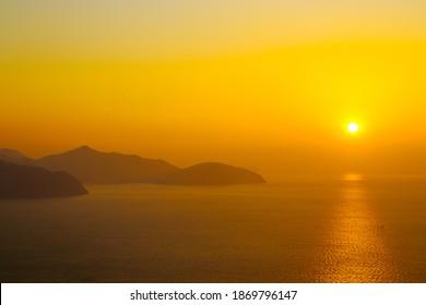 gold tone sunrise sea horizontal