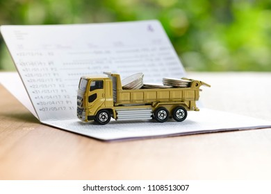 The gold truck full with coins on bankbook