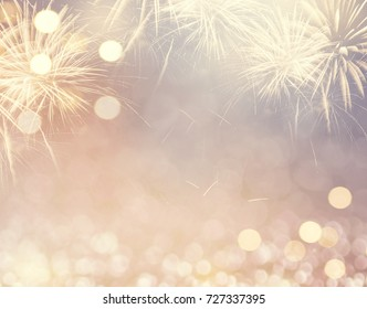 gold vintage fireworks and bokeh in new year eve and copy space abstract background holiday