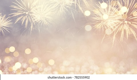 Gold Vintage Fireworks and bokeh in New Year eve and copy space. Abstract background holiday.