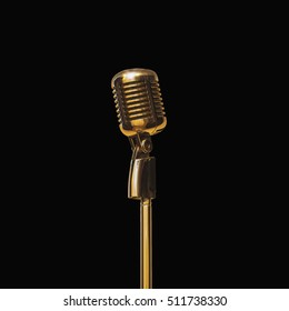 Gold vintage microphone in the studio on black with clipping path.