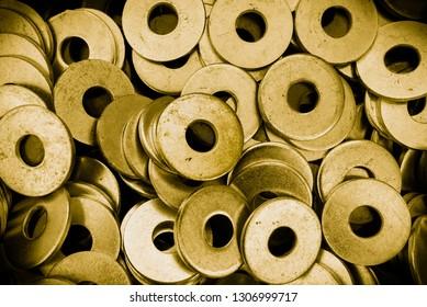 Gold washers rings. Hi-tech metal background.