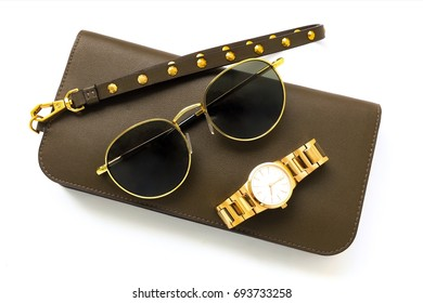 gold watch and sunglases and wallet