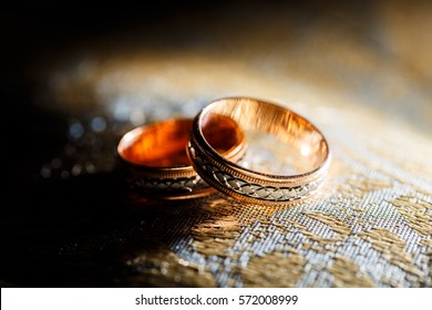 Gold wedding ring with an engraving