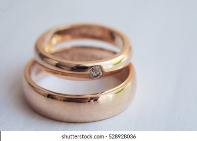 gold wedding rings with diamond close up