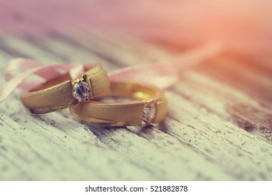 Gold wedding rings with diamond  - vintage filter.