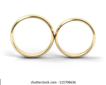Gold wedding rings engraved with the text Newlyweds