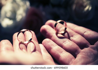 gold wedding rings in a man's hand, Vintage toning