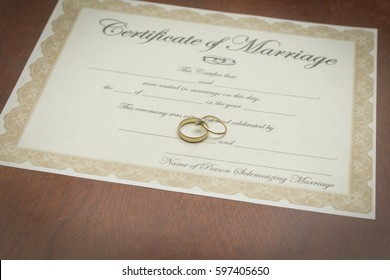 gold wedding rings on a marriage certificate